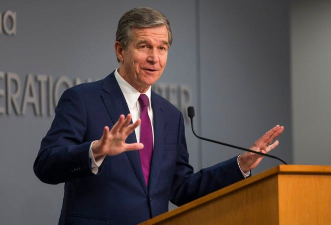 North Carolina Gov. Roy Cooper speaks to reporters during a COVID-19 news conference at the state Emergency Operations Center in Raleigh, N.C. on Wednesday, July 21, 2021. (Julia Wall/The News & Observer via AP)