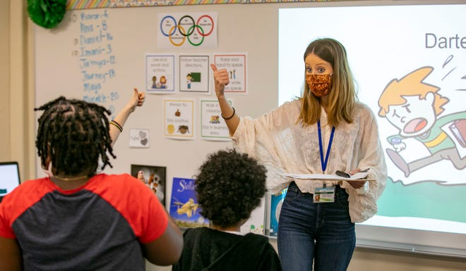 UF graduate student Christa Miller leads a class during the SAIL program at Idylwild Elementary School in Gainesville Tuesday. The program helps second- and third-graders with reading and UF graduate students get experience teaching.