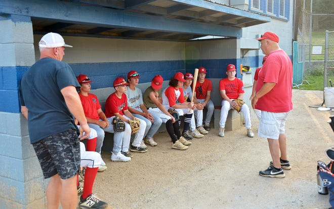 Hagerstown PONY 13U All-Stars manager Steve Berger, right, talks to his team before practice Tuesday evening. The team will travel to Modesto, Calif., for the PONY 13U World Series, which begins Friday.