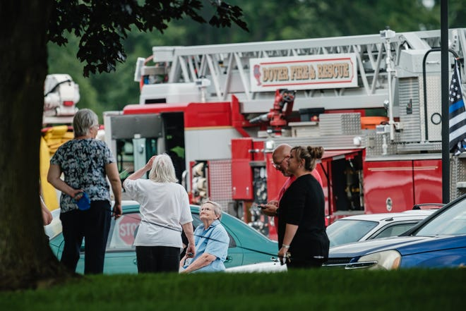 A resident of the Seton Square Dover II senior living facility (seated at center) waits clearance to return to her apartment, Wednesday, July 21 in Dover. Pictured at right is the manager, Heather Lawver.