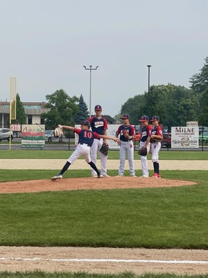 Charlie Keith warms up for a relief stint as teammates (left to right) Lucas Ira, Ian Wilcher, Cam Gates and Chase Norris look on Wednesday at the Little League Majors State Finals in Munster. Bedford stopped Silver Creek, 6-2.