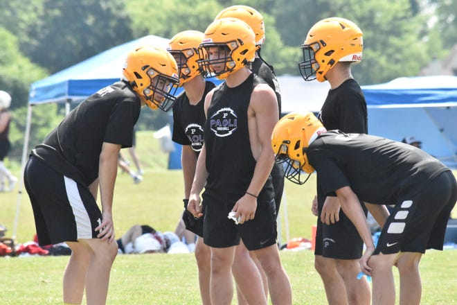 Paoli quarterback Carson Little relays a play call in the huddle during the Rams' trip to Mooresville for 7-on-7 competition. The Rams faced stiff competition in the tournament, helping them make progress toward the upcoming season.