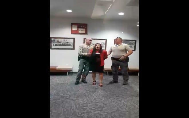Cellphone footage captures Victorville Councilwoman Blanca Gomez being arrested by deputies outside council chambers at Victorville City Hall on Tuesday, July 20, 2021.
