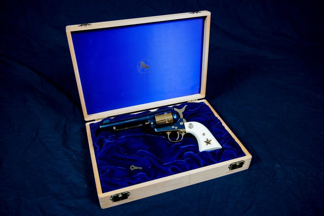 """""""The Alamo"""" is a Colt single-action revolver and the grand prize in the """"Sizzling Summer"""" opportunity drawing for the Happy Trails Children's Foundation."""