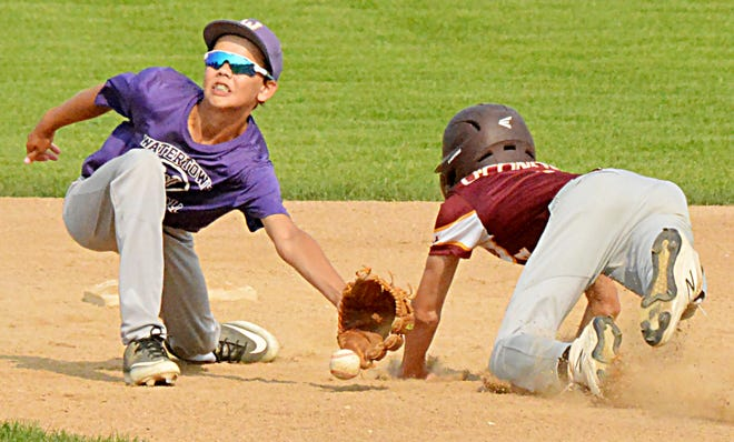 Watertown Grey Sox shortstop Carter Buisker attempts to haul in the throw as Harrisburg's Dylan O'Connor steals second base during their Class A U13 Baseball Doubleheader Tuesday night at Watertown Stadium. The Grey Sox won the opener 7-1, before having their 15-game winning streak end with an 11-6 loss in the second game.