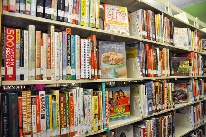 Cookbooks fill several shelves at the Abilene Public Library's Mockingbird Lane branch. They are to serve as inspiration for Cookbook Club participants to cook new recipes.