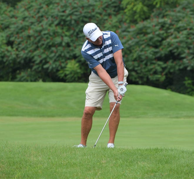 Steve Martin, from Dexter, chips in for eagle on No. 15 during the final round of the City Senior Championship at The Medalist Golf Club on Wednesday.