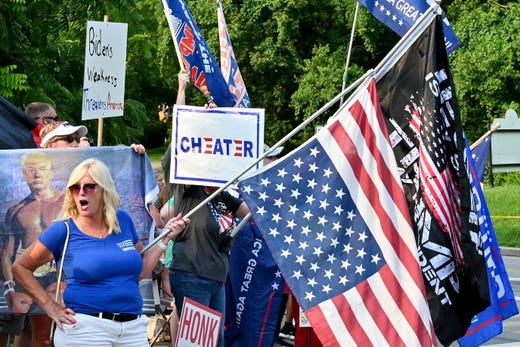 Joe Biden supporters and Donald Trump supporters gather on opposite sides of the street as Joe Biden visits Cincinnati for a CNN town hall on Wednesday, July 21, 2021.