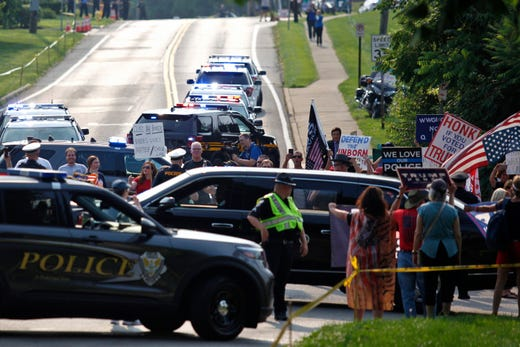 The motorcade carrying President Joe Biden passed by a gathering of supporters of former President Donald Trump, who gathered to protest the arrival of President Joe Biden outside of Mount Saint Joseph University where the President is set to speak at a town hall on Thursday, July 21, 2021, in Delhi.