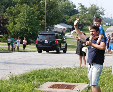 Alex Cunningham of Delhi and his son Luca, 4, watch the President's motorcade along Anderson Ferry Road.