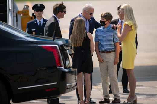 Kentucky Governor, Andy Beshear along with his wife, Britainy and children, Will and Lila greet President Joe Biden at Cincinnati/Northern Kentucky International Airport in Hebron, Ky., Wednesday, July 21, 2021. Biden was traveling to Cincinnati, for a town hall and to tour an electrical training center.