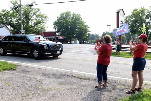 President Joe Biden motorcade passes along Anderson Ferry Road in Delhi Township, a suburb of Cincinnati to participate in a CNN town hall at Mount Saint Joseph University and tour a union training center Wednesday, June 14, 2021.