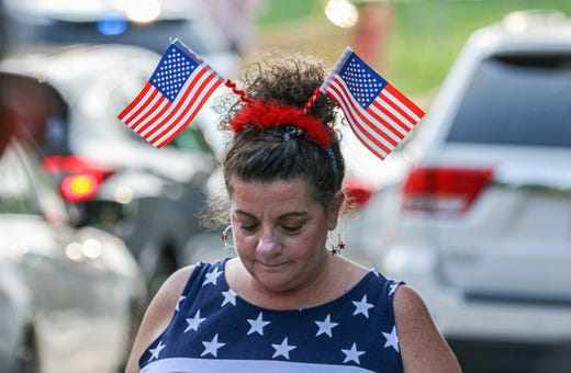 Darbie Porter,  a Trump supporter from Seven Mile, Ohio, walks back to her car after President Joe Biden's motorcade arrived  to the campus of Mount Saint Joseph University for a CNN town hall  Wednesday, June 14, 2021.