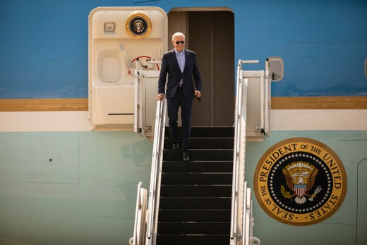President Joe Biden arrives at Cincinnati/Northern Kentucky International Airport in Hebron, Ky., Wednesday, July 21, 2021, to travel to Cincinnati, for a town hall and to tour an electrical training center.