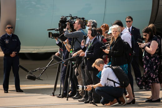 Members of the press watch as President Joe Biden arrives at Cincinnati/Northern Kentucky International Airport in Hebron, Ky., Wednesday, July 21, 2021, to travel to Cincinnati, for a town hall and to tour an electrical training center.