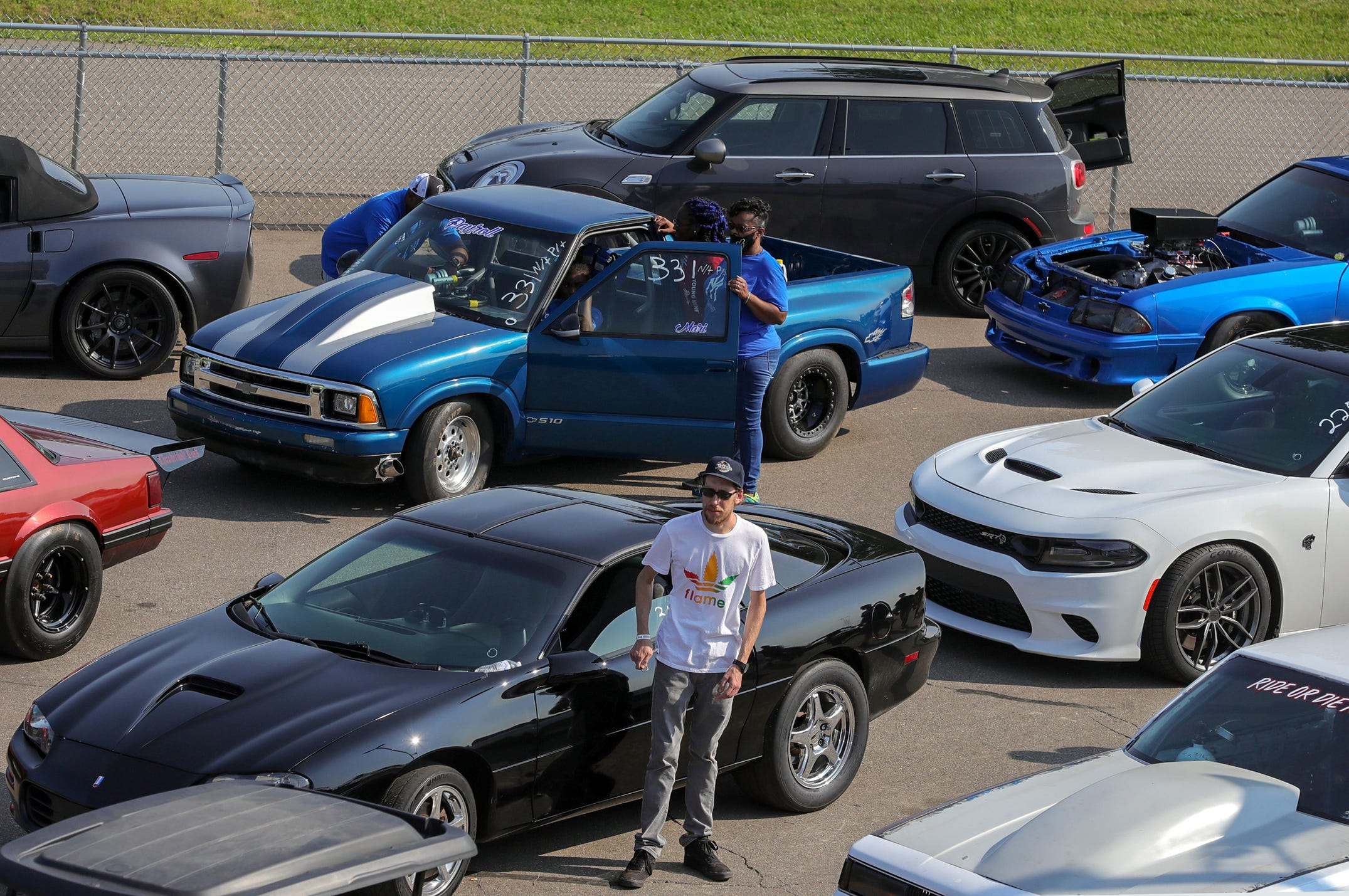 Joemari Fox, 21, waits in the staging area with his family before racing in an event sponsored by Payso Productions at Lapeer International Dragway on Saturday, July 17, 2021.