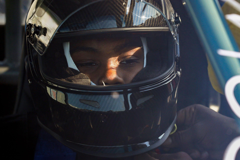 "Joemari Fox, 21, waits in his car ""Payroll"" before his pass at Lapeer International Dragway on Saturday, July 17, 2021."