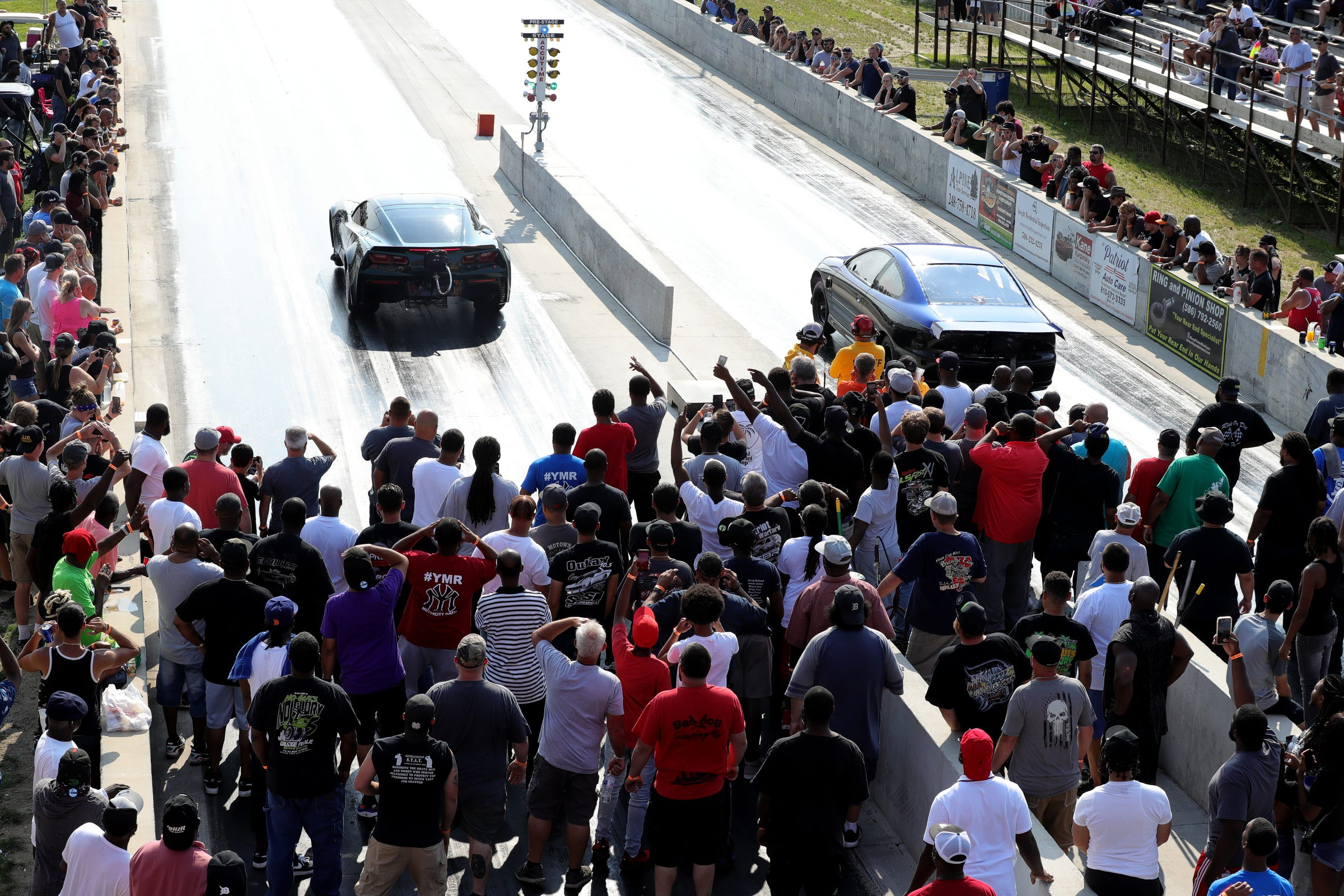 Fans cheer during a race at Lapeer International Dragway on Saturday, July 17, 2021. Hundreds of dollars are bet throughout the course of the day on the various races.
