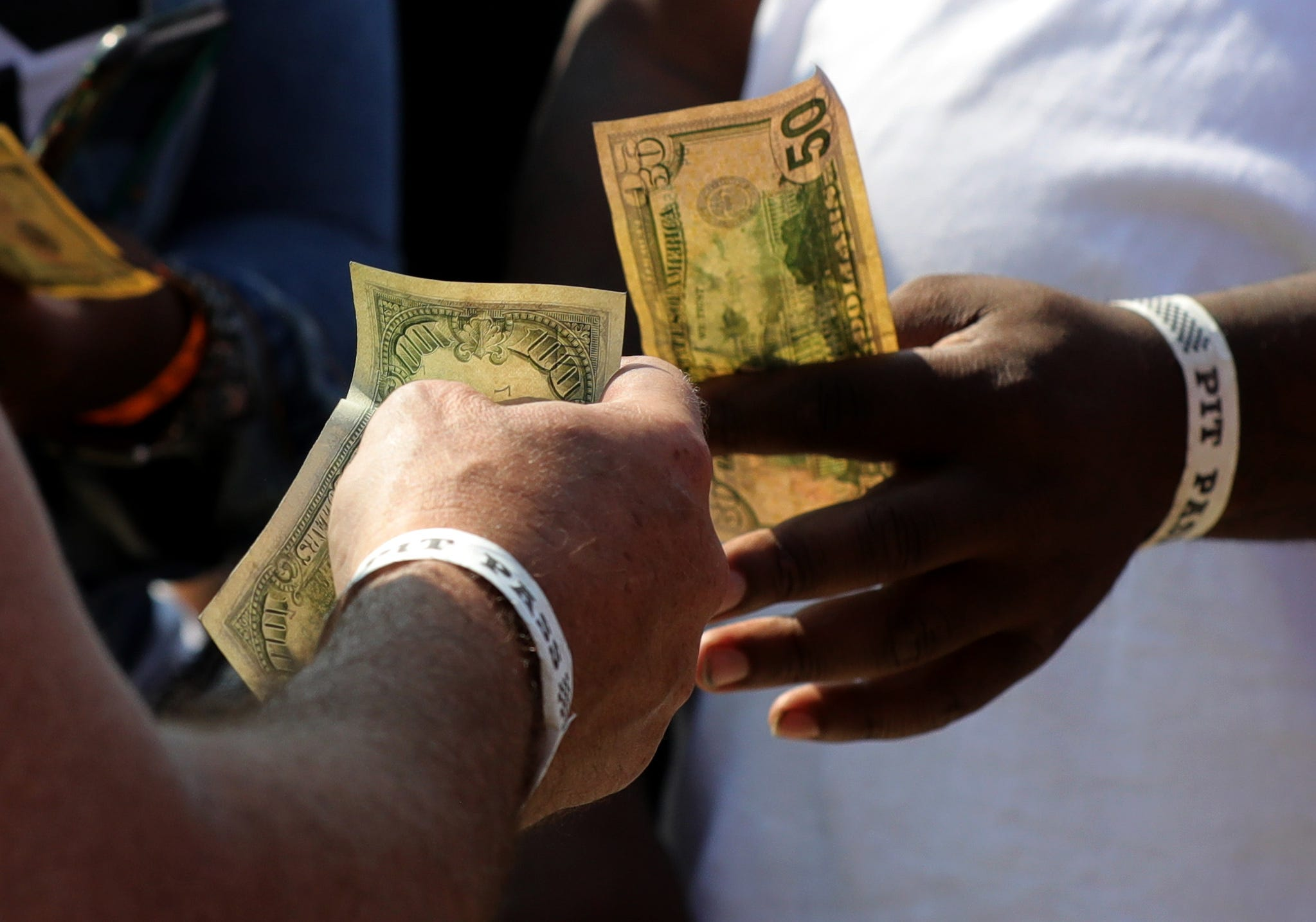 Fans make side bets during the races at Lapeer International Dragway on Saturday, July 17, 2021.