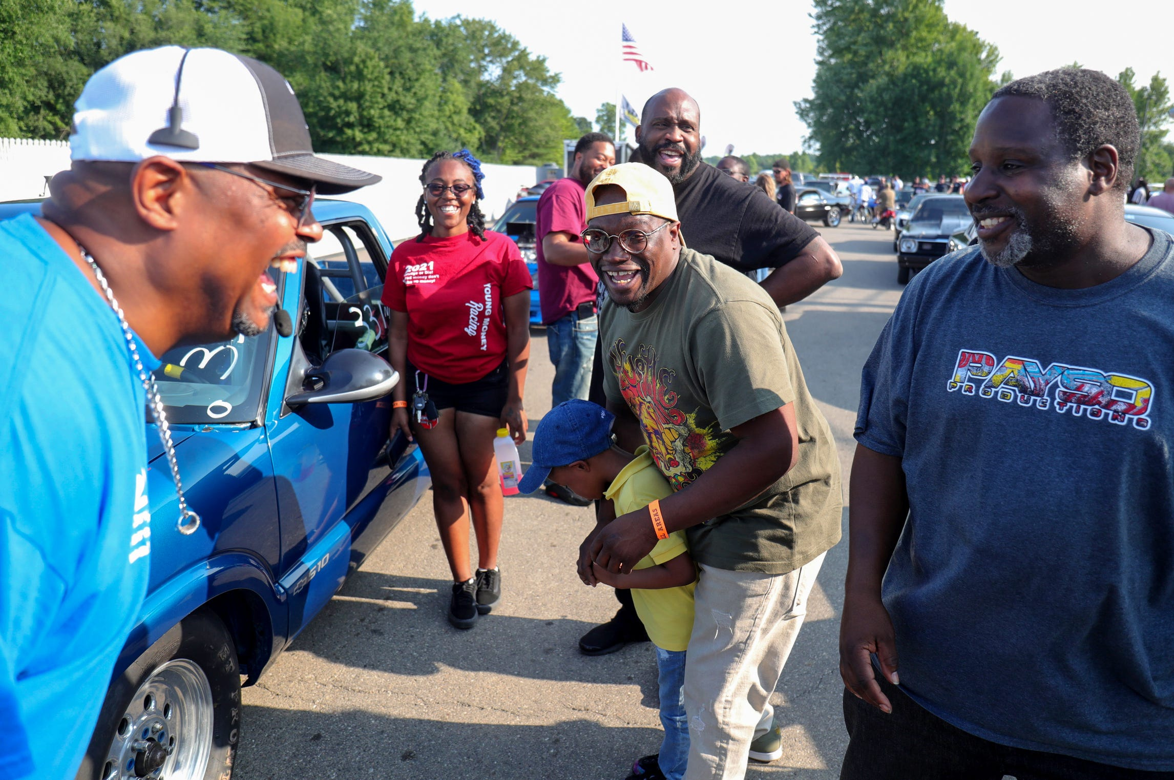 """Stafford Wilson and fellow racers do a little trash talking before his son Joemari Fox's race at Lapeer International Dragway Saturday, July 17, 2021. He completed the course in a little over 8 seconds. Joemari often catches attention because of his 5-foot-2, 115-pound frame and on this day one of his competitors pulled out his wallet and said """"Joemari sit on this so you can see over the steering wheel"""" his dad countered with """"My son will be making his second or third pass while you are still in the pits."""""""