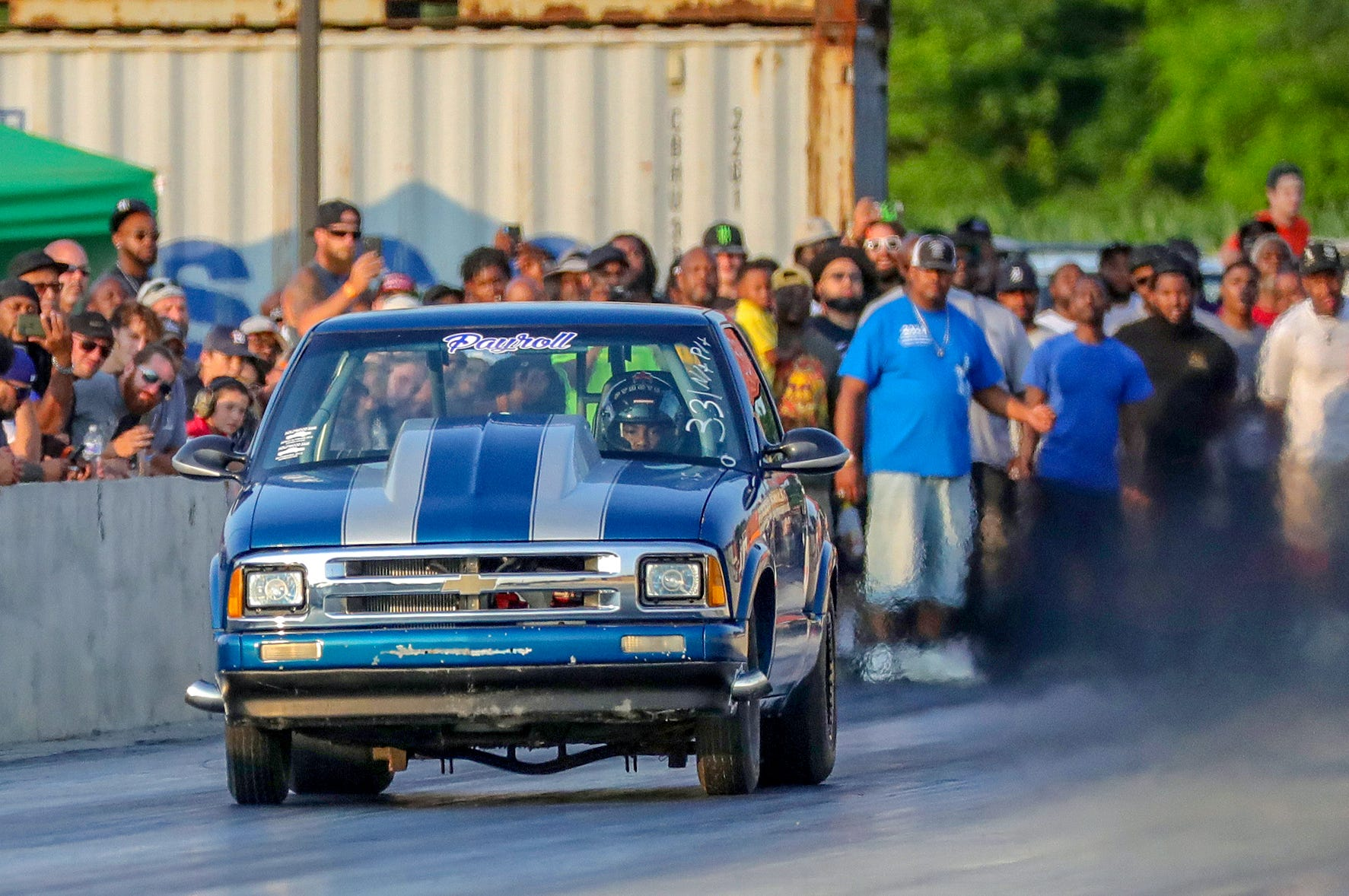 Joemari Fox, 21, peers over the steering wheel of his 1997 Chevrolet S-10 as he speeds down the track during his pass at Lapeer International Dragway on Saturday, July 17, 2021.