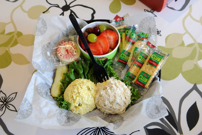 A scoop of egg salad, left, Olivia's Old South chicken salad, crackers and a fruit cup from the Chicken Salad Chick on Monday, July 20, 2021.