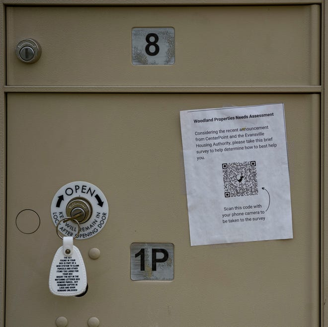 A sign asking residents to fill out a survey on their phone about their needs is taped to a residential mailbox at Woodland Park Apartments in Evansville, Ind., Wednesday, July 21, 2021. Recently CenterPoint Energy announced it would shut off power and natural gas to the residents if overdue payments were not made by management.