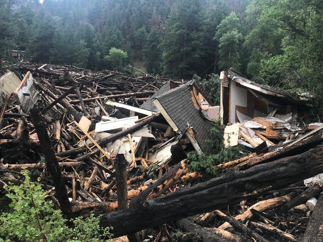 Scenes from Black Hollow Road, where a debris dam broke loose during flooding on Tuesday, July 20, 2021.