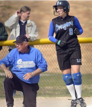 Lansing Catholic softball coach Hub Waite. right, and  Danielle Martin watch the batter during a game in 2005. Waite is part of the latest Greater Lansing Hall of Fame class.