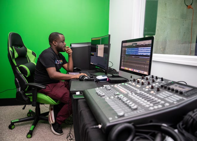 Traffic manager Jeremy McKnight works in the control room at Kudzukian's new headquarters  at the Agricenter on Tuesday, July 20, 2021.