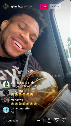 In a car with the Larry O'Brien Trophy and his NBA Finals MVP trophy, Giannis Antetokounmpo ordered Chick Fil-A the day after winning the title with the Milwaukee Bucks.