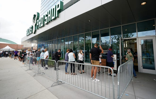 A line leads outside the Bucks Pro Shop to buy Bucks Championship merchandise at Fiserv Forum in Milwaukee on Wednesday, July 21, 2021.