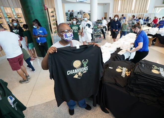 Vanda Brown of Milwaukee shops for Bucks championship merchandise at the Bucks Pro Shop at Fiserv Forum in Milwaukee on Wednesday, July 21, 2021.