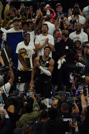 Milwaukee Bucks forward Giannis Antetokounmpo (34) celebrates after the Bucks won Game 6 of the NBA Finals at Fiserv Forum in Milwaukee on Tuesday, July 20, 2021.