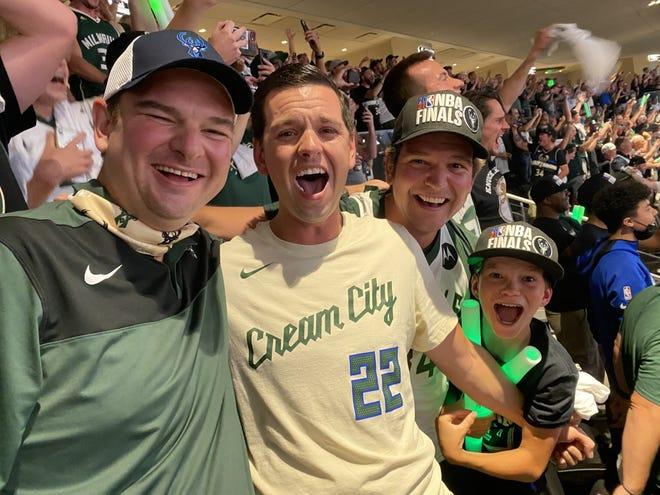 Brothers John, Matt and Ben Juech, and Ben's son, Charlie, celebrate the Milwaukee Bucks' NBA Championship win from inside Fiserv Forum July 20, 2021.