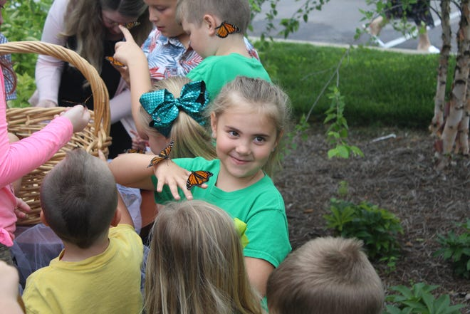Children release butterflies at Alive Hospice's Murfreesboro location  in spring 2019 for the nonprofits annual memorial butterfly release