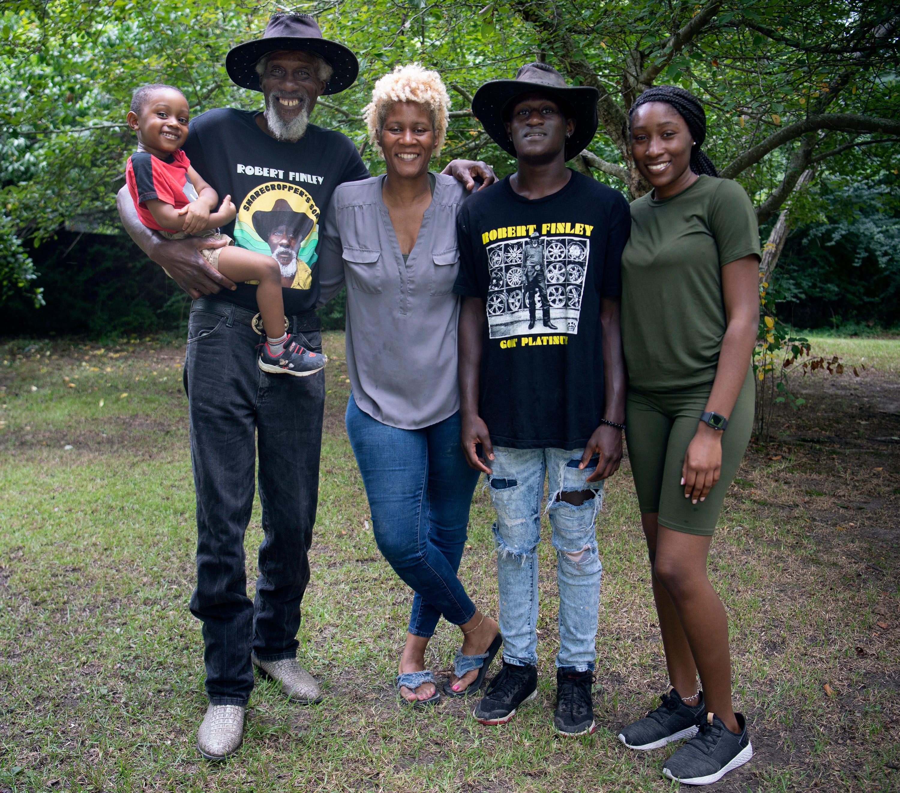 Robert Finley is close to the rest of his family in Bernice, Louisiana. Here he is with, from left. great-grandson Elijah McMahon, daughter Christy Johnson, and grandchildren Andre and LaQuindrelyn McMahon. Photographed Friday, July 16, 2021 in Bernice, La.