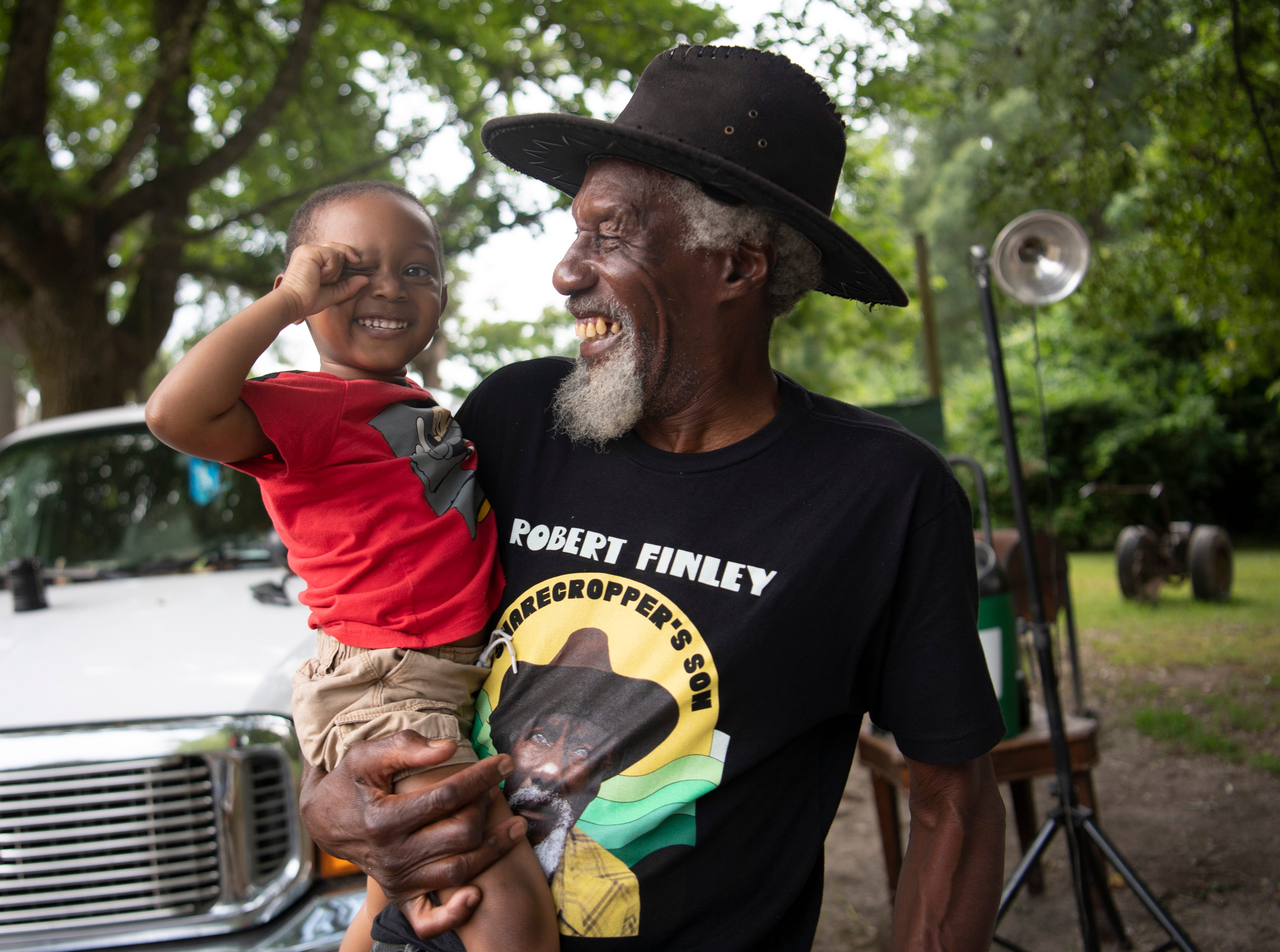 Robert Finley shares a laugh with great-grandson Elijah McMahon at his home in Bernice, La.  Photographed Friday, July 16, 2021.