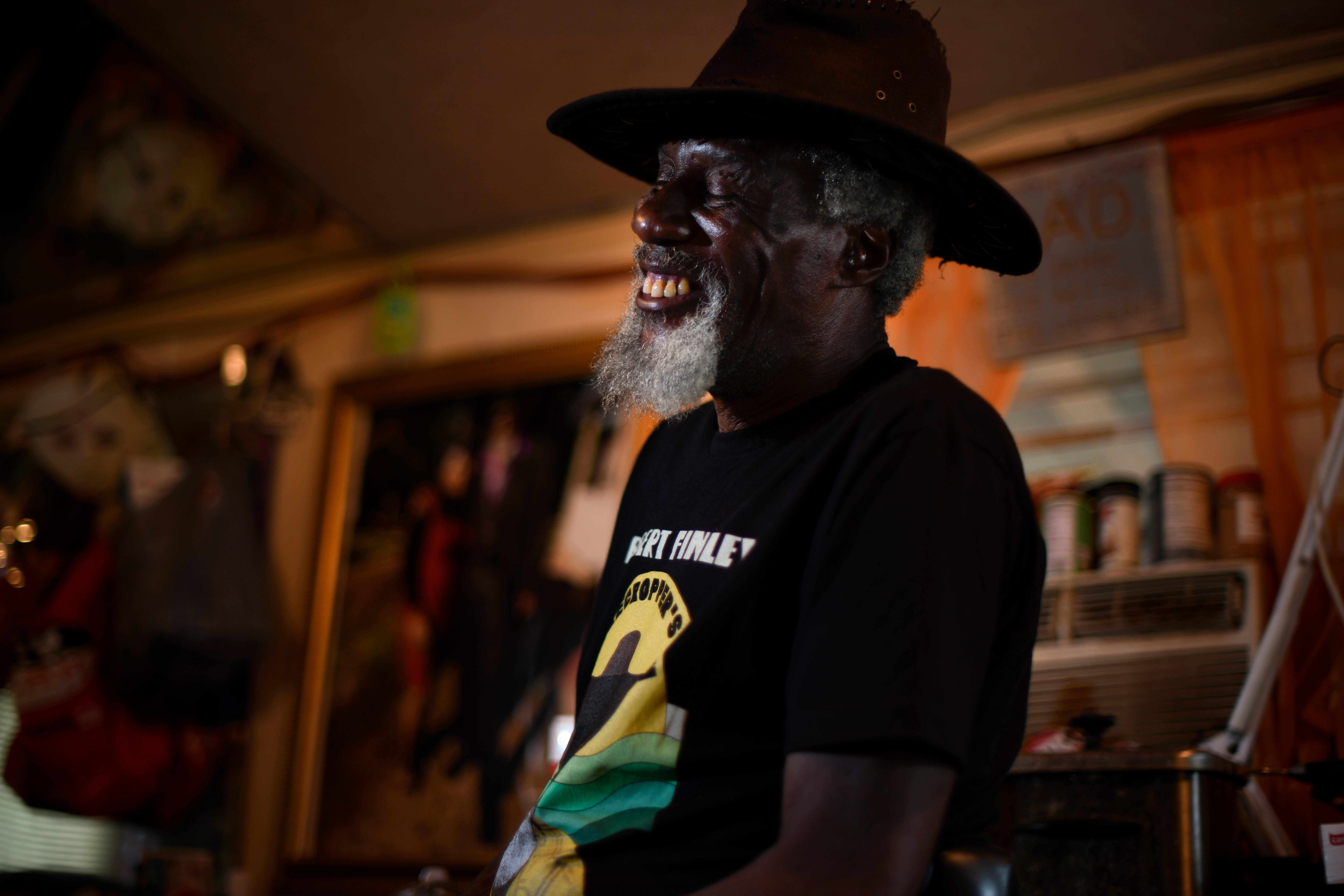 """Robert Finley laughs with guests at his home in Bernice, Louisiana, on  July 16, 2021. """"He's larger than life,"""