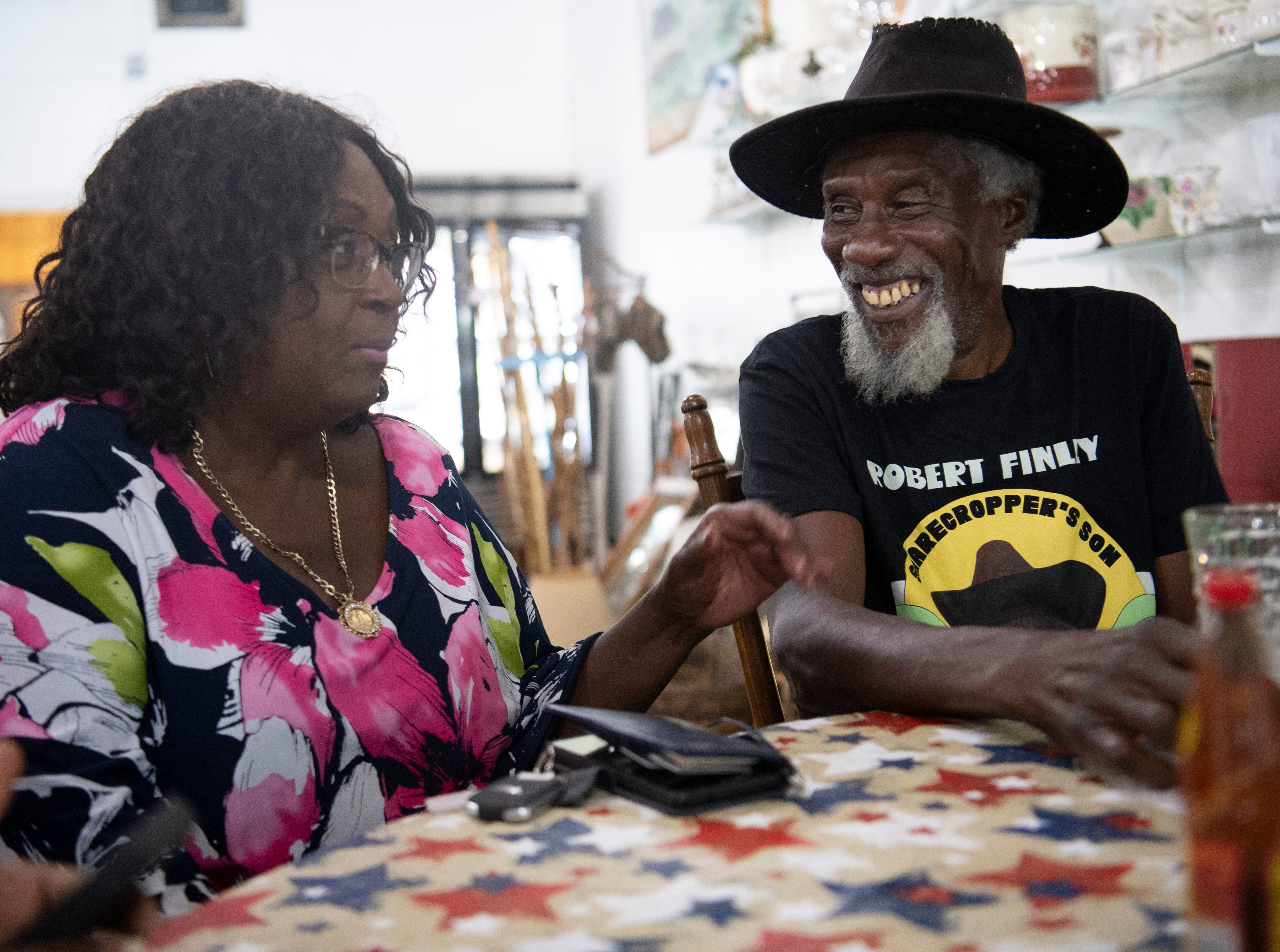 """Mildred Ferguson gets ready to eat with Robert Finley at a restaurant in Bernice, La.  """"He can sing with the kings and beggars, and he's the same,"""" said Ferguson, who is the mayor of Bernice and a longtime friend. Photographed Friday, July 16, 2021."""