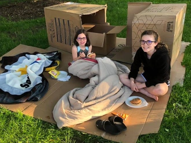 Maggie and Molly Miller, members of the All Creatures 4-H Club in Johnstown, prepared to camp out in the Johnstown square as part of the group's Box City project in 2019. The annual event, in which people drive by and donate money and food to a local pantry, was canceled in 2020 during the pandemic, but is returning this Friday.