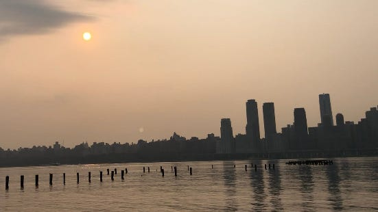 A hazy sunrise over the Hudson River on Wednesday, July 21, 2021 as smoke from western wildfires continues to blanket New Jersey and New York.