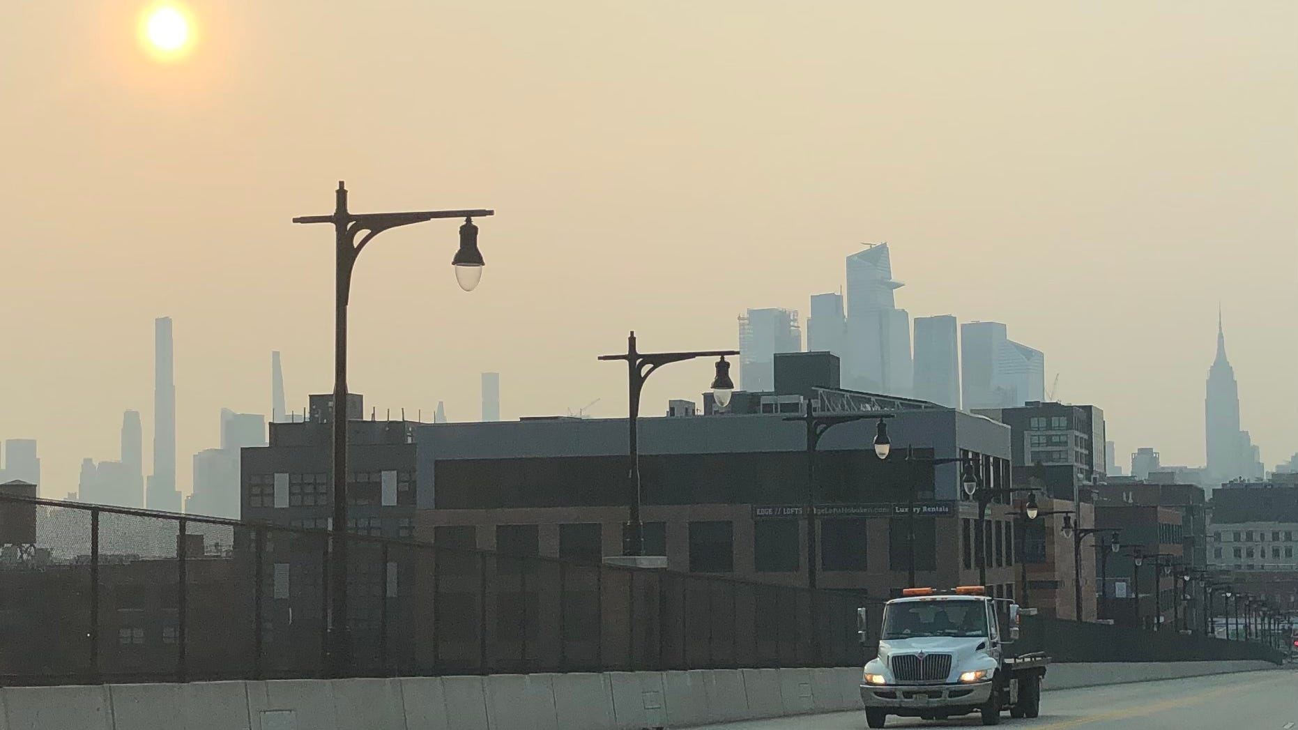 A hazy sunrise on Wednesday July 21, 2021 over Hoboken as smoke from western wildfires continues to blanket New Jersey and New York for a second day.