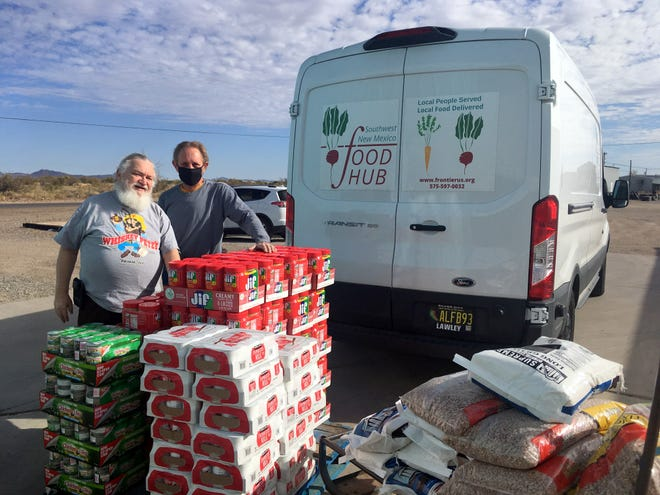 John and Rusty of Deming Helping Hand Food Pantry receive a shipment from the Southwest New Mexico Food Hub..
