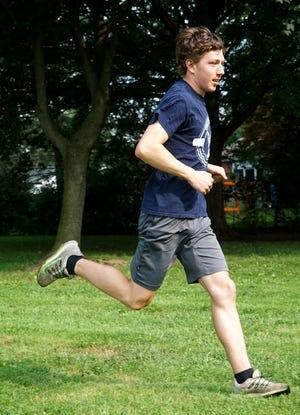 Peter Baracco runs at Farmington Hills' Drake Park.