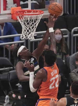 Phoenix Suns center Deandre Ayton (22) blocks a shot by Milwaukee Bucks guard Jrue Holiday (21) during Game 6 of the NBA Finals at Fiserv Forum July 20, 2021.