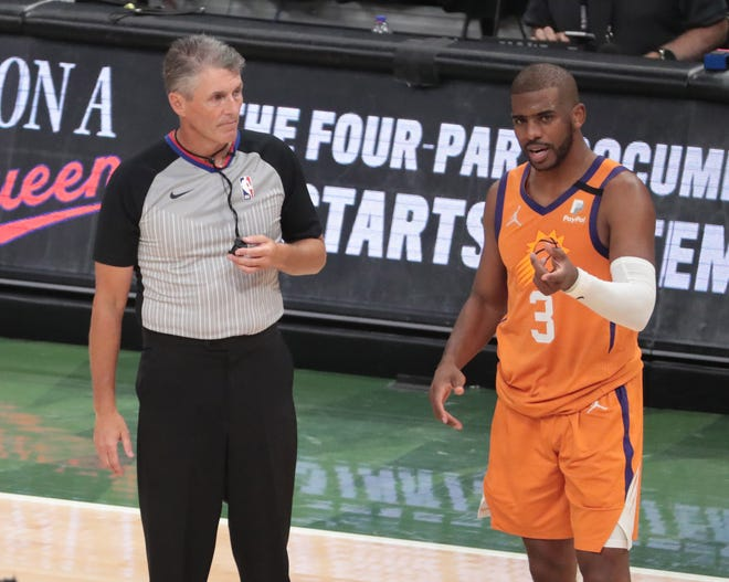 Phoenix Suns guard Chris Paul (3) questions a call by referee Scott Foster (48) during Game 6 of the NBA Finals against the Milwaukee Bucks at Fiserv Forum July 20, 2021.