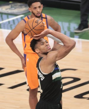 Milwaukee Bucks forward Giannis Antetokounmpo (34) shoots a free throw against the Phoenix Suns during Game 6 of the NBA Finals at Fiserv Forum July 20, 2021.