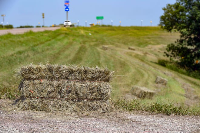 Hay bales rest alongside the highway on Tuesday, July 20, 2021 outside Flandreau.