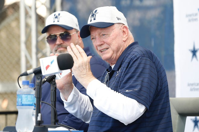Dallas Cowboys Coach Mike McCarthy, from left, and owner Jerry Jones talk to the media Wednesday during training camp in Oxnard.
